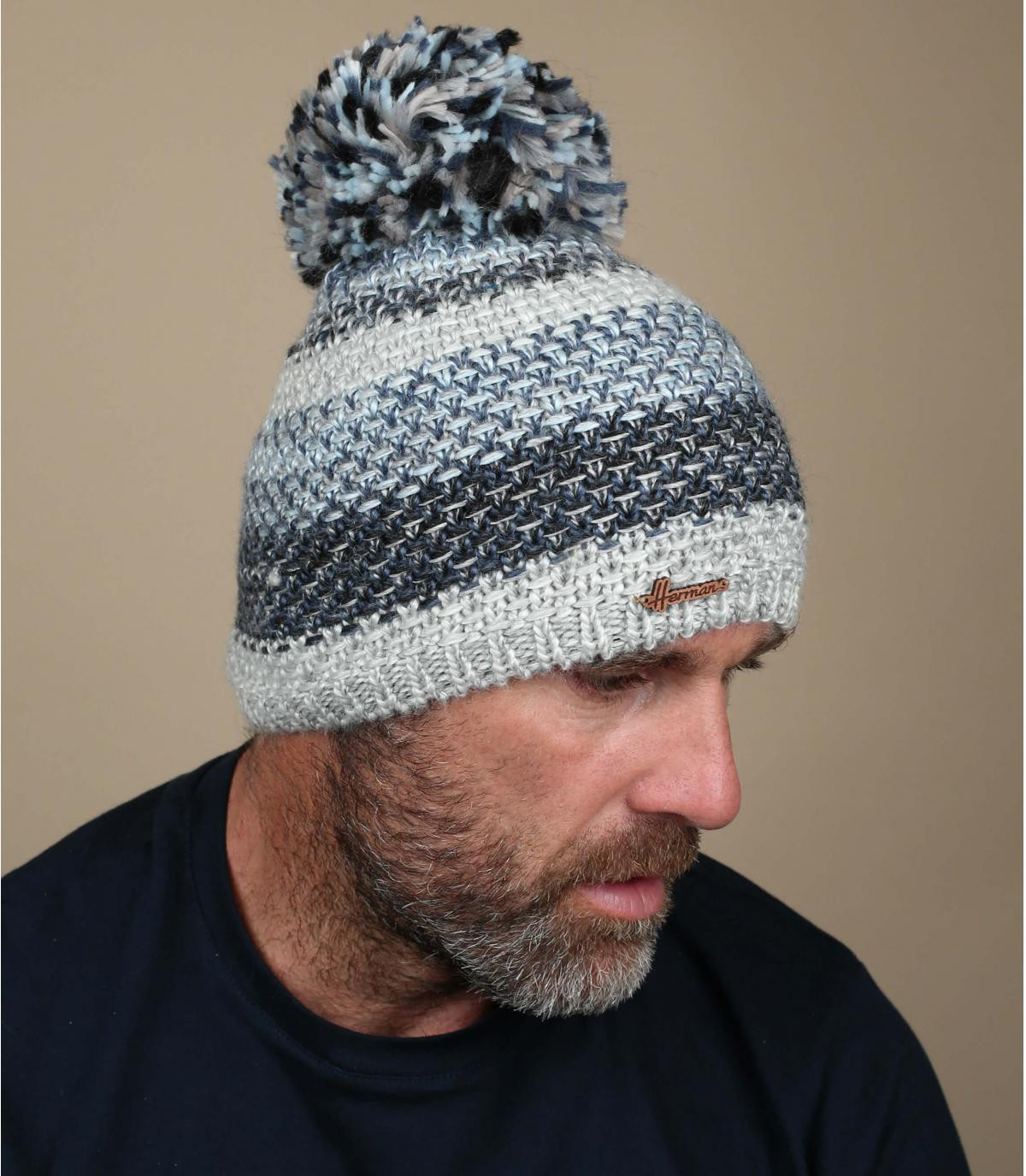 cappello pompon a strisce blu