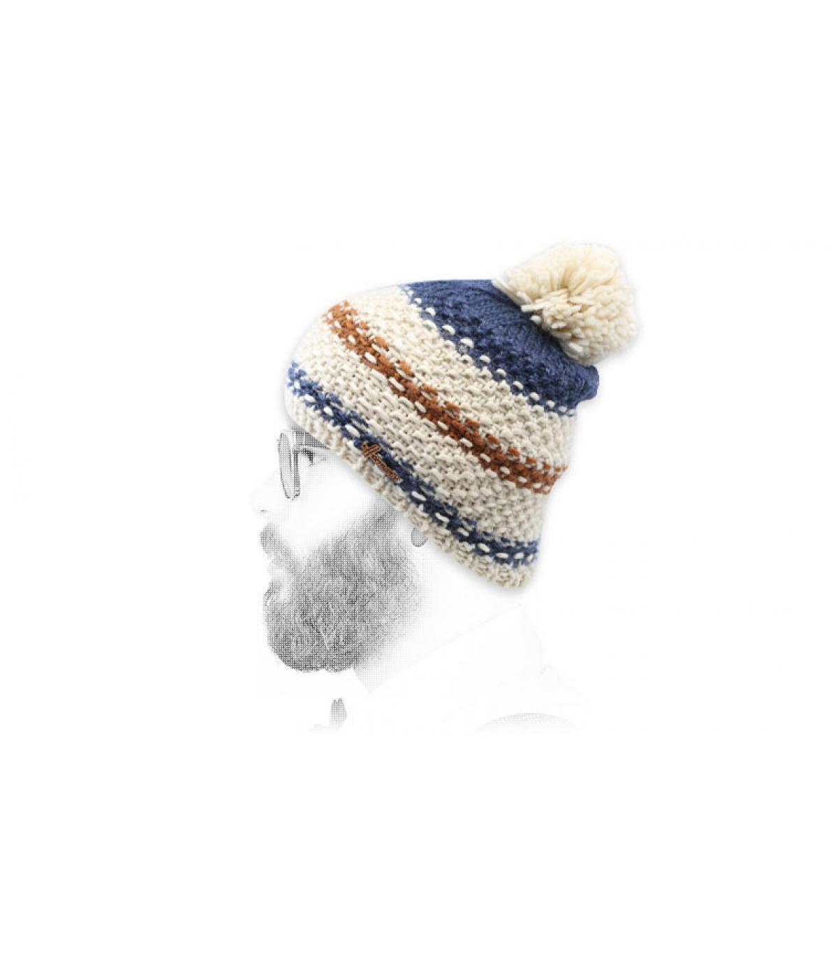 cappello blu con nappe a strisce blu