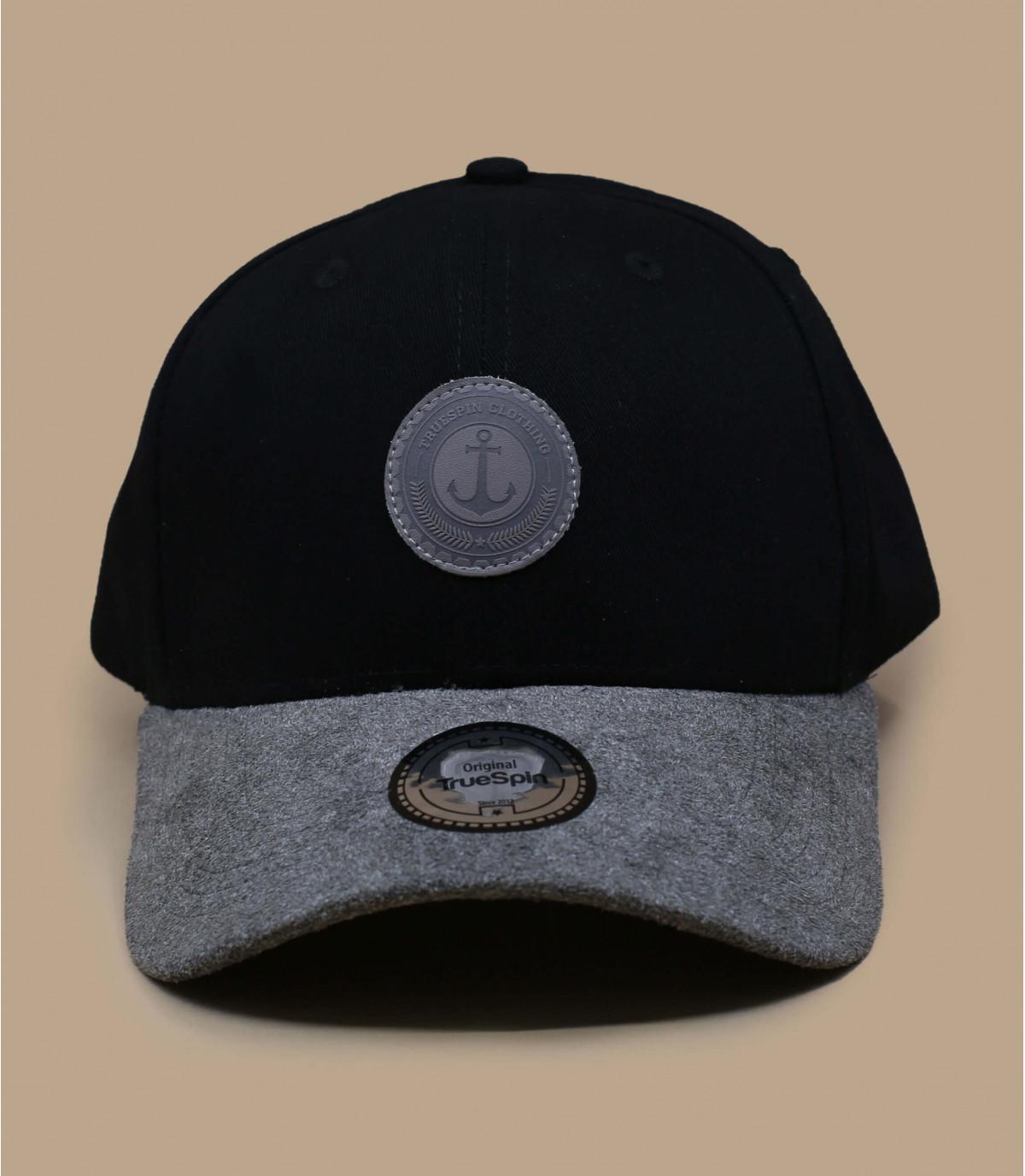 berretto nero con visiera in pelle